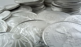 Gold Dips as Other Metals Gain, US Silver Coins Rise