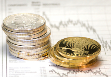 How does a bullish dollar and stock picture affect gold and silver?