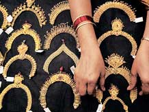 Gold slips from nearly 4-mth high, down Rs 475 on global cues