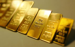 Gold Edges Up Week, Silver Surges; US Mint Bullion Coins Mixed