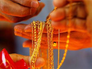 Gold rebounds on fresh buying; silver plunges