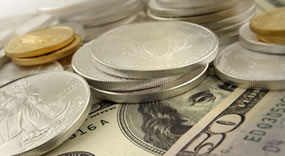 Gold Adds 20 Cents, Silver Falls 0.7%; US Mint Bullion Coins Jump
