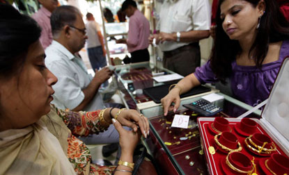 Gold price rebounds on festive demand, silver remains weak