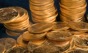 Gold Rebounds from 3-Year Low, Down on Week; US Gold Coins Up