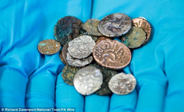 Iron Age coins found in a cave: 26 gold and silver pieces that have laid …