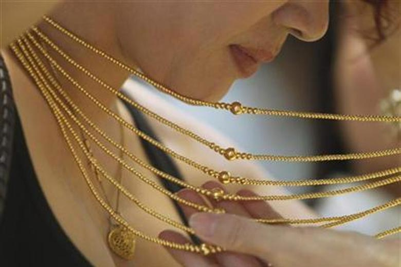 Gold up Rs 100 in opening trade, rebounds on Asian cues   The Financial Express