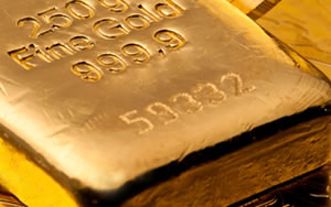 Gold Climbs After Fed Statement; US Mint Sales Gain